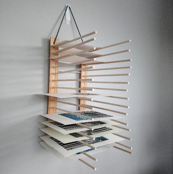 Print or Art Drying Rack made from wood and dowel rods suitable for an art or printmaking studio. Step 7 - add the hanging cord